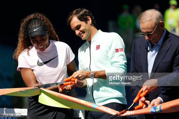 Serena Williams of the United States Roger Federer of Switzerland and Miami Dolphins owner Stephen Ross cut the ribbon during the Ribbon Cutting...