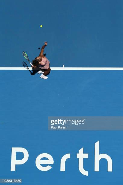 Serena Williams of the United States serevs to Maria Sakkari of Greece during day three of the 2019 Hopman Cup at RAC Arena on December 31, 2018 in...