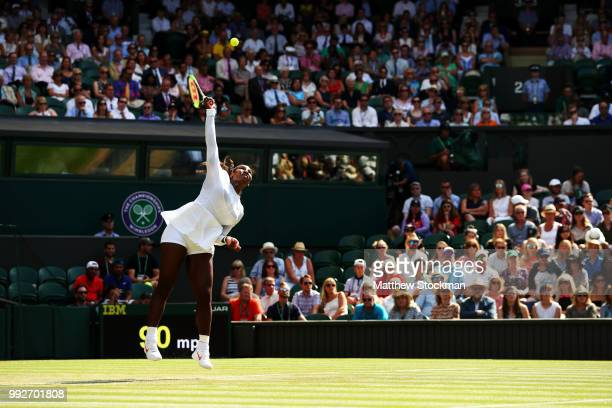 Serena Williams of the United States serves against Kristina Mladenovic of France during their Ladies' Singles third round match on day five of the...