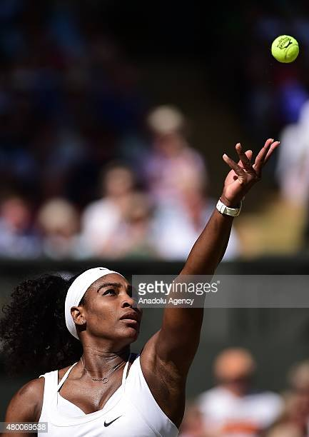 Serena Williams of the United States serves against Maria Sharapova of Russia during day ten of the Wimbledon Lawn Tennis Championships at the All...