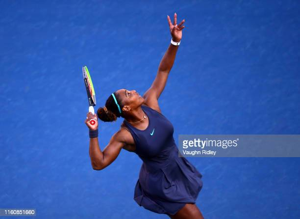 Serena Williams of the United States serves against Marie Bouzkova of Czech Republic during a semifinal match on Day 8 of the Rogers Cup at Aviva...