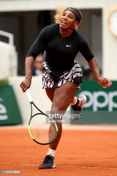 Serena Williams of The United States serves during her ladies singles first round match against Kurumi Nara of Japan during Day five of the 2019...