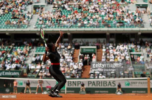 Serena Williams of The United States serves during her ladies singles first round match against Kristyna Pliskova of Czech Republic during day three...