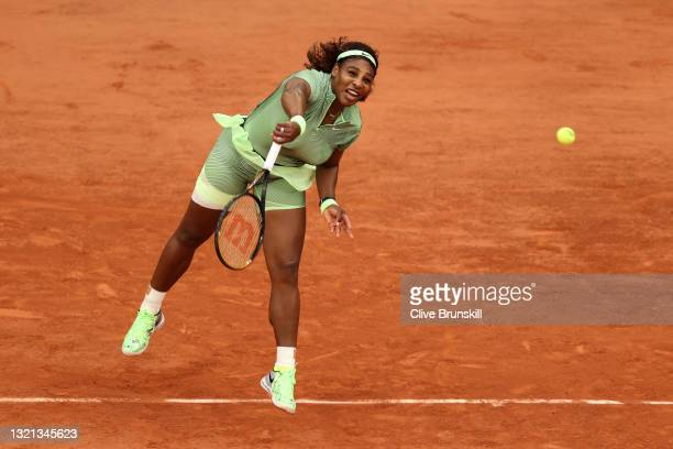 Serena Williams of the United States serves during her women's second round match against Mihaela Buzarnescu of Romania during day four of the 2021...