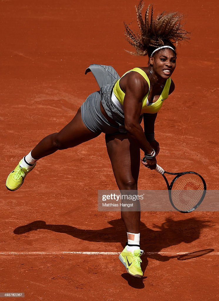 Serena Williams of the United States serves during her women's singles match against Alize Lim of France on day one of the French Open at Roland Garros on May 25, 2014 in Paris, France.