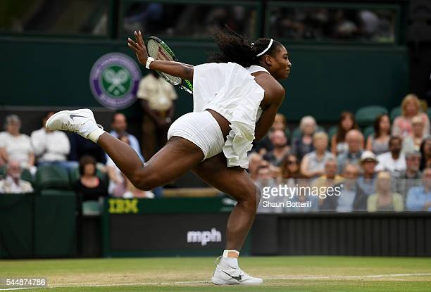 Serena Williams of The United States serves during the Ladies Singles fourth round match against Svetlana Kuznetsova of Russia on day seven of the...