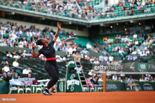 Serena Williams of The United States serves during the ladies singles second round match against Ashleigh Barty of Ausralia during day five of the...