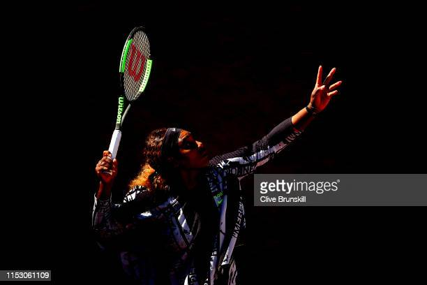 Serena Williams of The United States serves during the warm up ahead of her ladies singles third round match against Sofia Kenin of The United States...