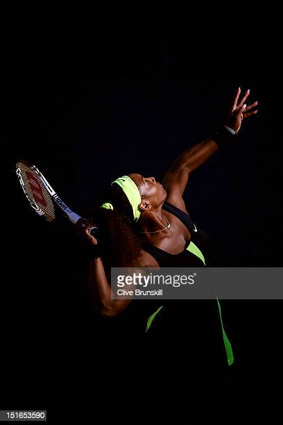 Serena Williams of the United States serves during the women's singles final match against Victoria Azarenka of Belarus on Day Fourteen of the 2012...