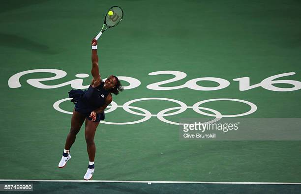 Serena Williams of the United States serves during the Women's Singles second round match against Alize Cornet of France on Day 3 of the Rio 2016...
