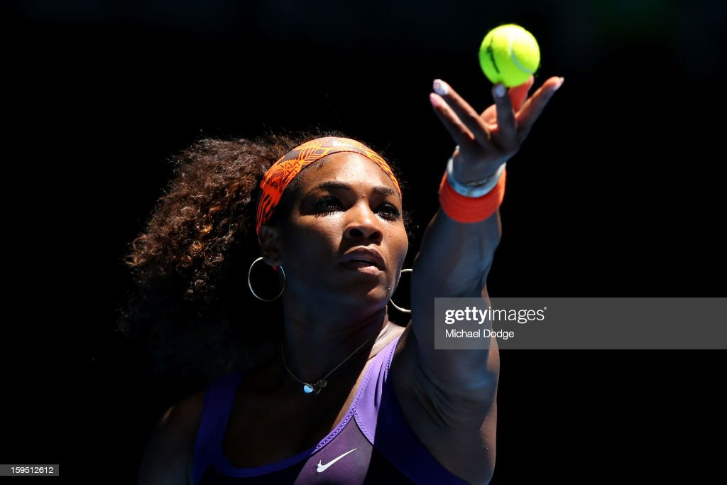 Serena Williams of the United States serves in her first round match against Edina Gallovits-Hall of Romania during day two of the 2013 Australian Open at Melbourne Park on January 15, 2013 in Melbourne, Australia.
