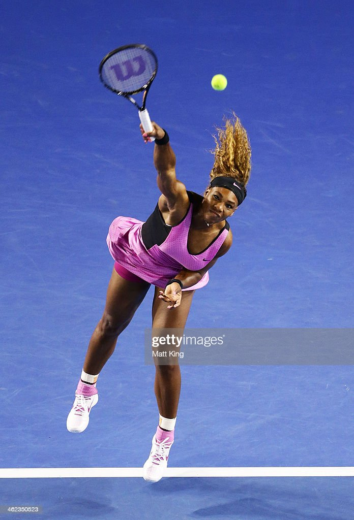 Serena Williams of the United States serves in her first round match against Ashleigh Barty of Australia during day one of the 2014 Australian Open at Melbourne Park on January 13, 2014 in Melbourne, Australia.
