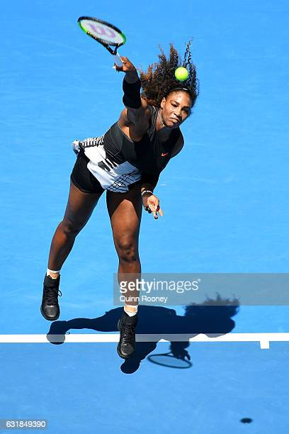 Serena Williams of the United States serves in her first round match against Belinda Bencic of Switzerland on day two of the 2017 Australian Open at...