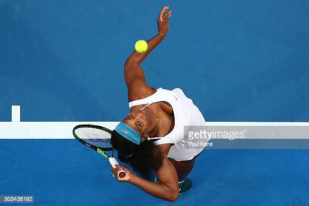 Serena Williams of the United States serves in her singles match against Jarmila Wolfe of Australia Gold with a knee in jury during day three of the...