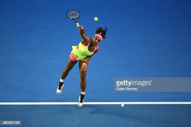 Serena Williams of the United States serves in her women's final match against Maria Sharapova of Russia during day 13 of the 2015 Australian Open at...