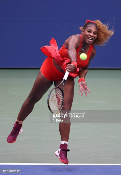 Serena Williams of the United States serves the ball during her Women's Singles first round match against Kristie Ahn of the United States on Day Two...