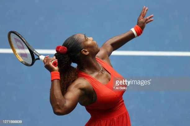 Serena Williams of the United States serves the ball during her Women's Singles quarterfinal match against Tsvetana Pironkova of Bulgaria on Day Ten...