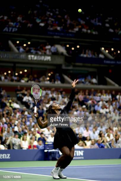 Serena Williams of the United States serves the ball during the women's singles quarterfinal match against Karolina Pliskova of Czech Republic on Day...