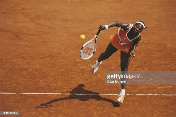 Serena Williams of the United States serves to Ai Sugiyama of Japan during their Women's Singles fourth round match of the French Open on 1 June 2003...