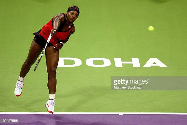 Serena Williams of the United States serves to Venus Williams of the United States in round robin play during the Sony Ericsson WTA Championships at...