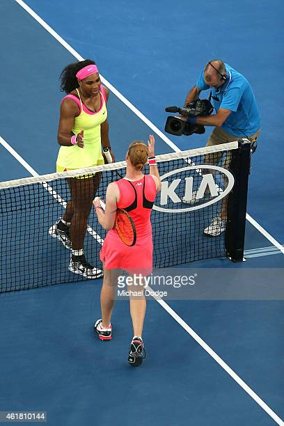 Serena Williams of the United States shakes hands after winning her first round match against Alison Van Uytvanck of Belgium during day two of the...