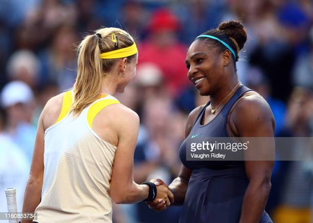 Serena Williams of the United States shakes hands with Marie Bouzkova of Czech Republic following a semifinal match on Day 8 of the Rogers Cup at...