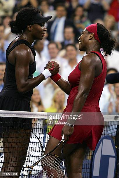 Serena Williams of the United States shakes hands with Venus Williams of the United States after Serena defeated Venus during Day 10 of the 2008 US...