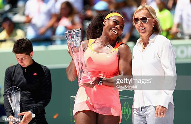 Serena Williams of the United States shares a joke with Martina Navratilova of the United States as she holds the Butch Bucholz Trophy after her...