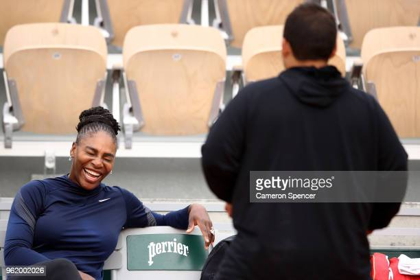 Serena Williams of the United States shares a laugh during a practice session ahead of the French Open at Roland Garros on May 24 2018 in Paris France