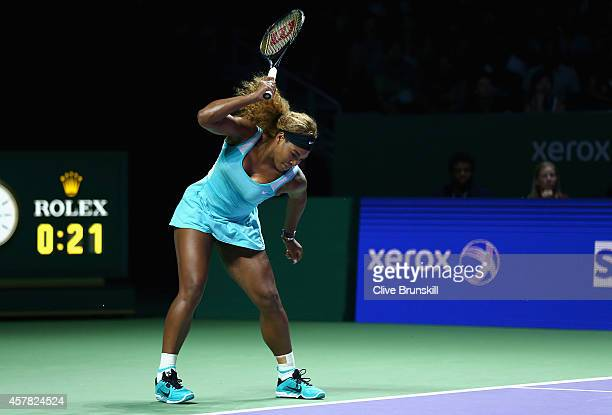 Serena Williams of the United States shows her frustration as she smashes her racket on the court playing against Caroline Wozniacki of Denmark in...