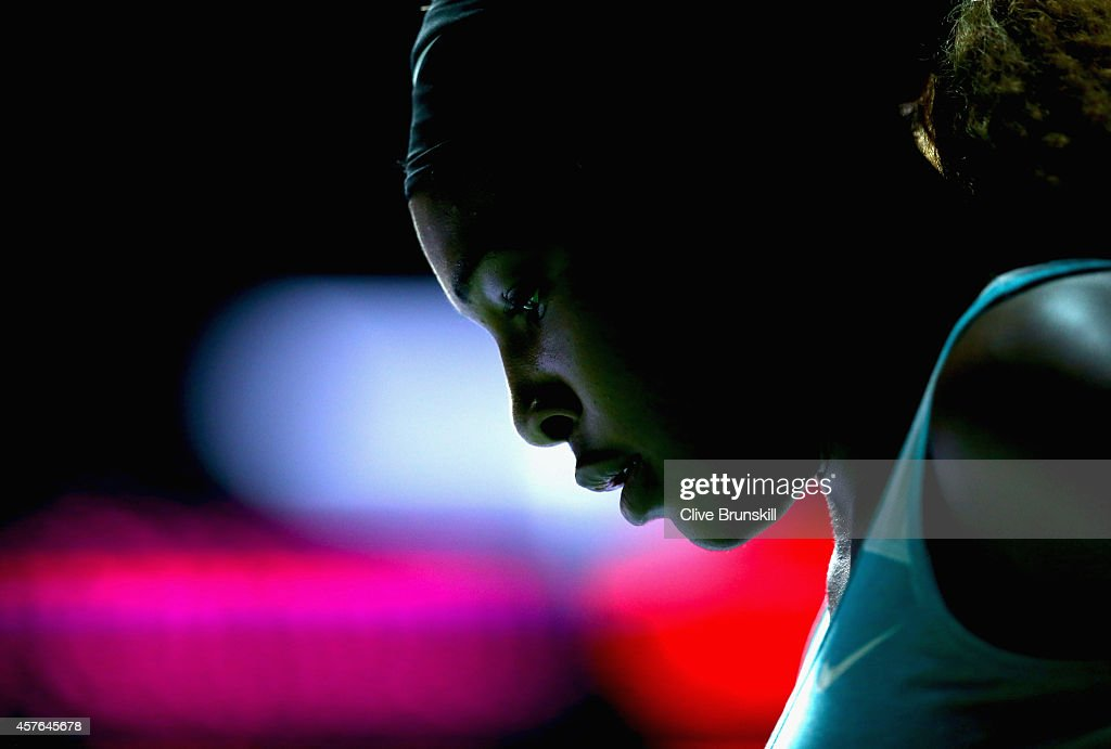 Serena Williams of the United States shows her frustrations during her straight sets defeat by Simona Halep of Romania in their round robin match during the BNP Paribas WTA Finals at Singapore Sports Hub on October 22, 2014 in Singapore.