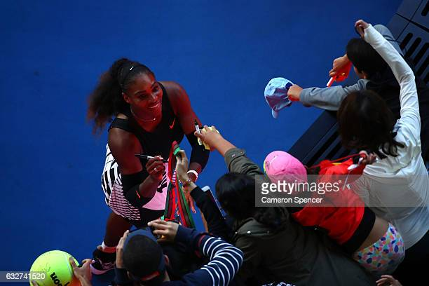 Serena Williams of the United States signs autographs for fans after winning her semifinal match against Mirjana LucicBaroni of Croatia on day 11 of...