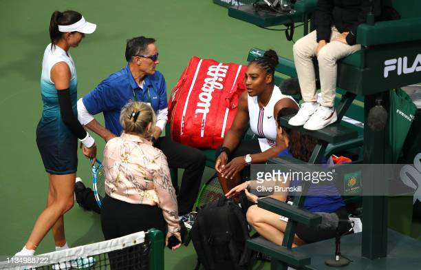 Serena Williams of the United States sits down with medical staff after retiring from her match in at the start of the second set against Garbine...