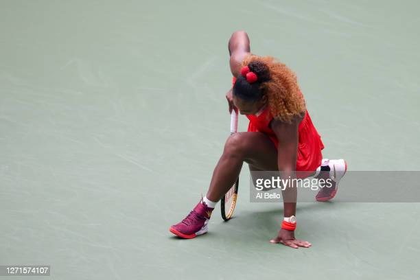 Serena Williams of the United States slides during her Women's Singles quarterfinal match against Tsvetana Pironkova of Bulgaria on Day Ten of the...
