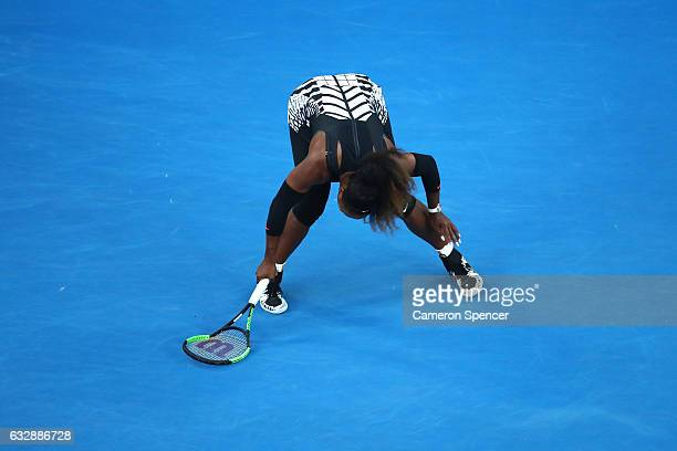 Serena Williams of the United States slips and breaks her racquet in her Women's Singles Final match against Venus Williams of the United States on...