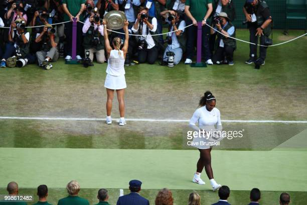 Serena Williams of The United States smiles as winner Angelique Kerber of Germany poses for photographs with the Venus Rosewater Dish after the...