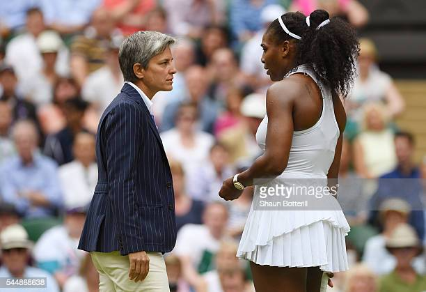 Serena Williams of The United States speaks to The Umpire after they inspect the court during the Ladies Singles fourth round match against Svetlana...