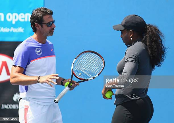 Serena Williams of the United States speaks with her coach Patrick Mouratoglou during day two of the 2016 Australian Open at Melbourne Park on...