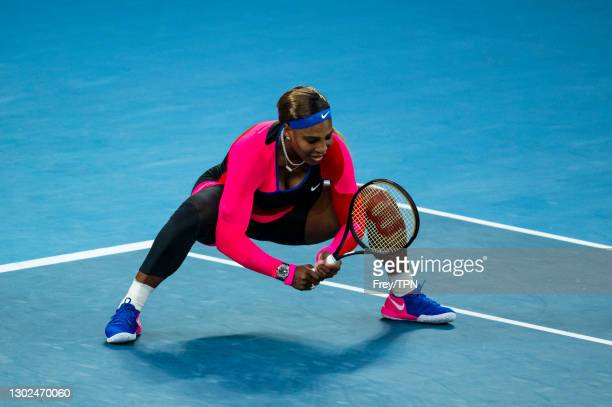 Serena Williams of the United States squats down after missing a shot against Simon Halep of Romania during day nine of the 2021 Australian Open at...