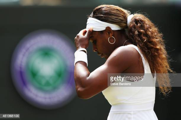 Serena Williams of the United States stands dejected during her Ladies' Singles third round match against Alize Cornet of France on day six of the...