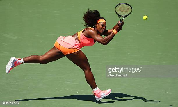Serena Williams of the United States stretches to play a backhand against Svetlana Kuznetsova of Russia in their fourth round match during the Miami...