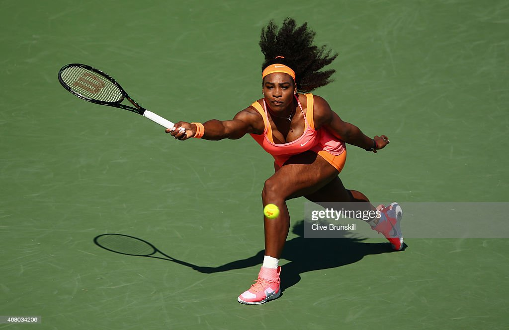 Serena Williams of the United States stretches to play a forehand against Catherine Bellis of the United States in their third round match during the Miami Open Presented by Itau at Crandon Park Tennis Center on March 29, 2015 in Key Biscayne, Florida.