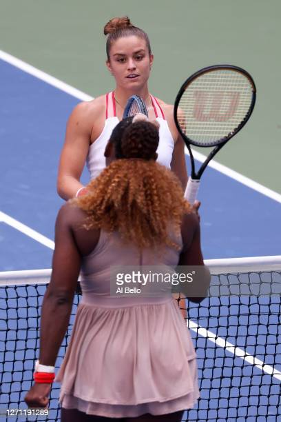 Serena Williams of the United States talks at the net with Maria Sakkari of Greece after winning their Women's Singles fourth round match on Day...