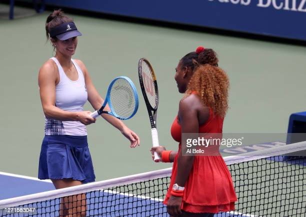 Serena Williams of the United States taps rackets with Tsvetana Pironkova of Bulgaria after winning their Women's Singles quarterfinal match on Day...