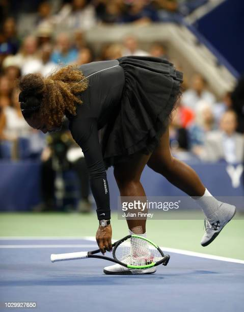 Serena Williams of the United States throws her racket to the ground in frustration in the Women's Singles finals match against Naomi Osaka of Japan...