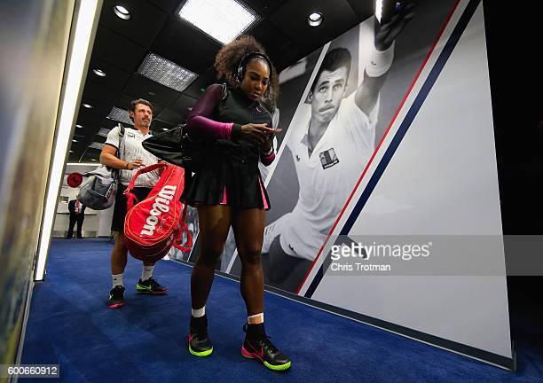 Serena Williams of the United States walks down the player hallway followed by coach Patrick Mouratoglou on her way to the court before playing...