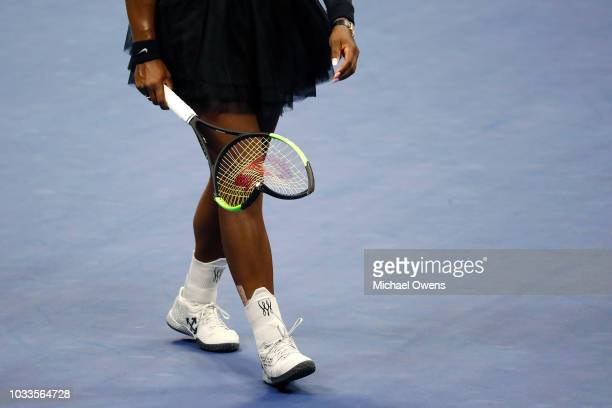 Serena Williams of the United States walks off after smashing her racket during her Women's Singles finals match against Naomi Osaka of Japan on Day...