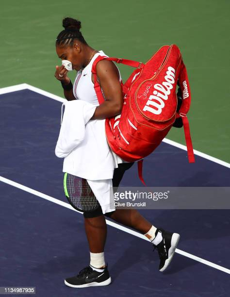 Serena Williams of the United States walks off court after retiring from her match in at the start of the second set against Garbine Muguruza of...