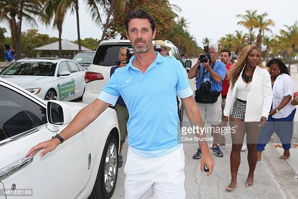Serena Williams of the United States walks off Crandon Park beach to her car as coach and boyfriend Patrick Mouratoglou opens the door for her after...