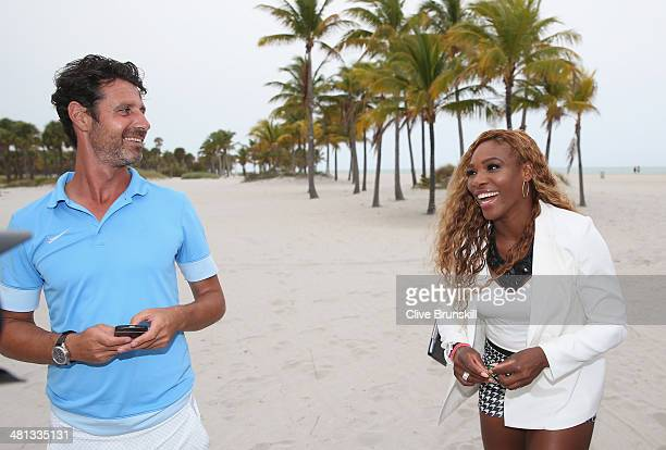 Serena Williams of the United States walks on Crandon Park beach and smiles to her coach and boyfriend Patrick Mouratoglou after her straight sets...